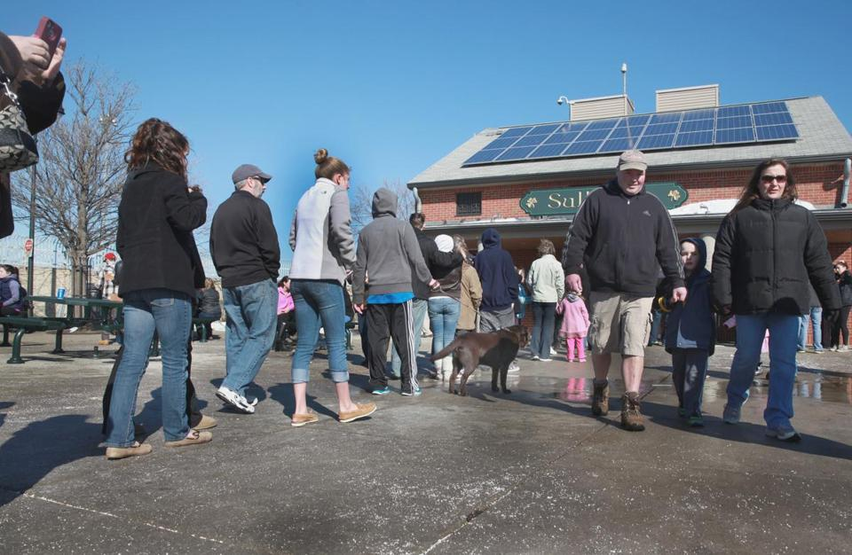 Crowds lined up at Sullivan's Saturday. The temperature reached 50; it will be 49 Sunday.
